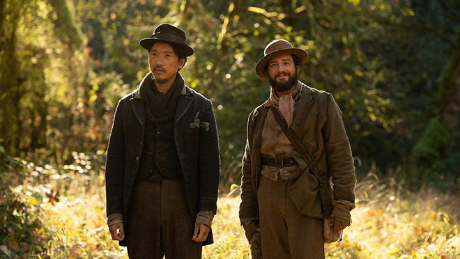 """Orion Lee, left, and John Magaro star in """"First Cow."""""""