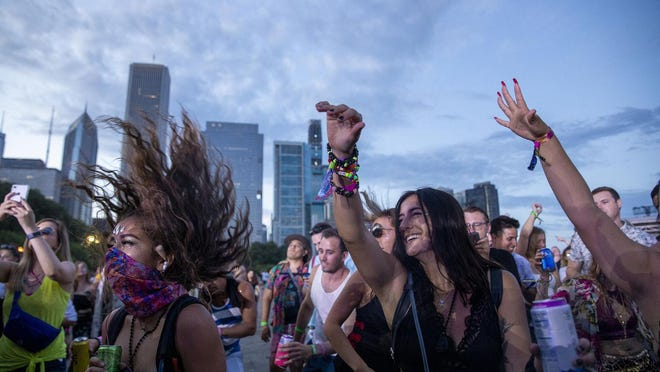 Attendees of the 2019 Lollapalooza Music Festival dance to Crizzly in Grant Park last August.