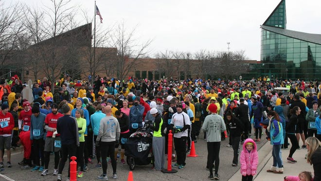 A large crowd gathers for the 12th annual Turkey Trot for a Cause in Canton to raise money to fight epilepsy.