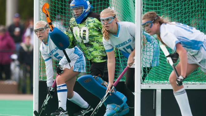 South Burlington goalie Elizabeth Sargent (00) and the defense wait for a corner during the Division I field hockey state championship game between Champlain Valley Union and South Burlington.