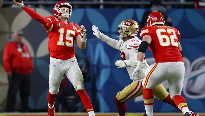 Kansas City Chiefs quarterback Patrick Mahomes (15) throws in the pocket against San Francisco 49ers safety Jimmie Ward (20) in Super Bowl LIV at Hard Rock Stadium on Feb. 2.