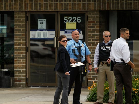 Members of the Lansing  Police Department and the FBI are on scene at Comerica Bank in the 5200 block of S. Cedar in Lansing Wednesday afternoon, June 28, 2017.   A bank robbery was reported at 2:51 p.m.   A male left the bank and left on foot.  Tracking with K-9 was unsuccessful.  [MATTHEW DAE SMITH/Lansing State Journal]