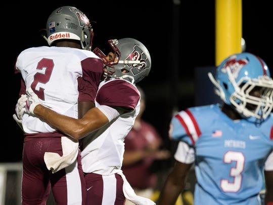 Westside quarterback Junior Smith (2) celebrates with Westside's Jaylen Ware (11) after scoring a touchdown against J.L. Mann on Thursday, Oct. 12, 2017.