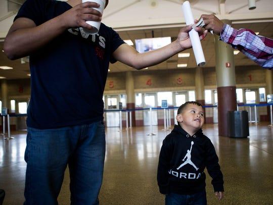 Edwin Antonio Gonzalez, 24, receives sugar packets