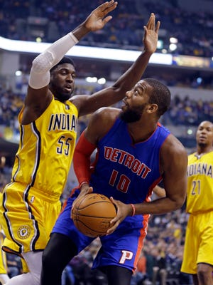 Indiana Pacers center Roy Hibbert (55) defends Detroit Pistons forward Greg Monroe (10) during the first half of an NBA basketball game in Indianapolis, Friday, Jan. 16, 2015.