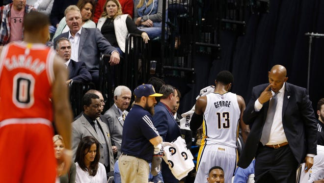 Pacers president Larry Bird and fans watched Saturday as Paul George (13) headed to the locker room after being ejected from the game for kicking a ball into the stands  at Bankers Life Fieldhouse.