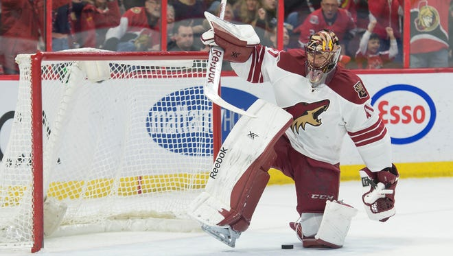 Arizona Coyotes goalie Mike Smith (41)  reacts following a goal scored by the Ottawa Senators in the second period at the Canadian Tire Centre.
