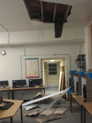 Part of a ceiling collapsed inside a computer lab at Conesville Elementary School over the weekend, officials report. The building was vacant for the summer. No one was injured.