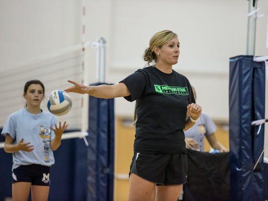 Coach Randi Jakubiak instructs players during volleyball practice Thursday, August 11, 2016 at Marysville High School.