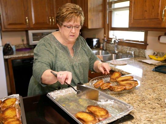 Linda Frentz arranges German ham and Swiss cheese sandwiches