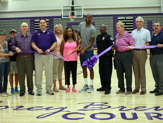 Corey Brewer cuts the ribbon the the Portland High