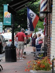 Visitors enjoy the shopping area in downtown Milford.