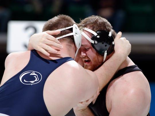 Iowa's Sam Stoll, right, and Penn State's Nick Nevills