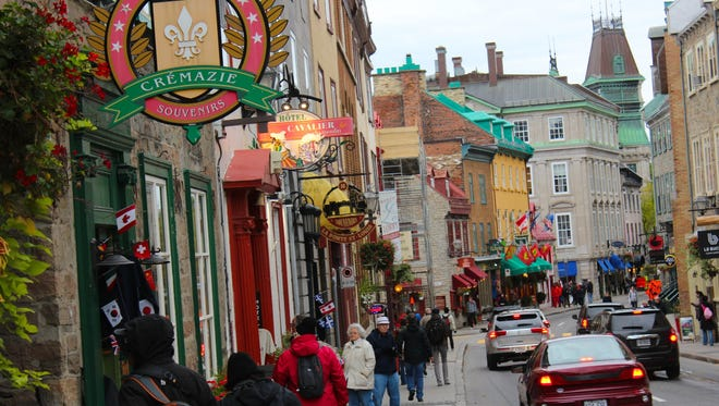 In the Upper Town of Quebec City, fall visitors enjoy the brisk days.
