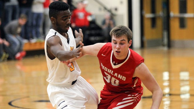Lone Tree's Jovonte Squiers guards Highland's Trent Lasek during their game in Lone Tree on Tuesday, Dec. 15, 2015. Squiers was named co-player of the year in the SEISC on Tuesday.
