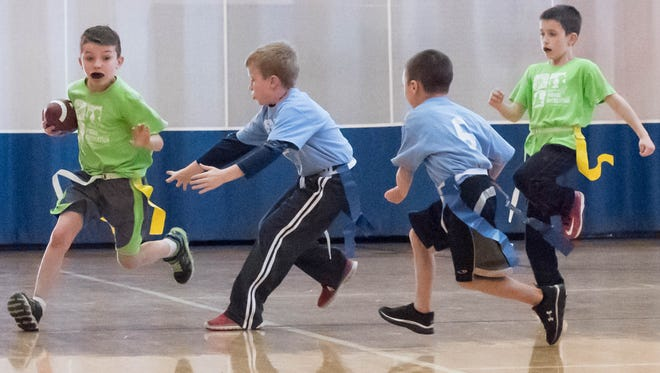Carter Groleau, 7 advances the ball for some yardage during flag football at Full Blast.