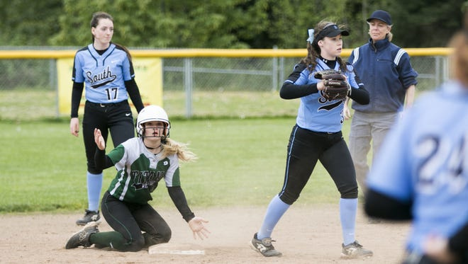 West Salem's Taylor Holmquist (7) reacts to being called out after a catch by South Salem's Alison Gebhardt (3) in a Greater Valley Conference softball game on Tuesday, April 12, 2016, at West Salem High School. West Salem shut out South 8-0 after seven innings and a game delay for rain.