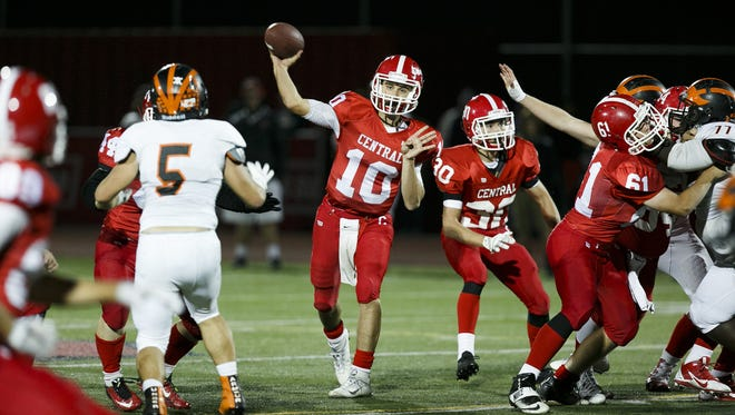 Central's Peter Mendazona (10) throws to an open teammate at a game against Dallas on Friday, Sept. 30, 2016, at Central High Schoo in Independence. The pass was blocked by Dallas' Cade Caudill (5).