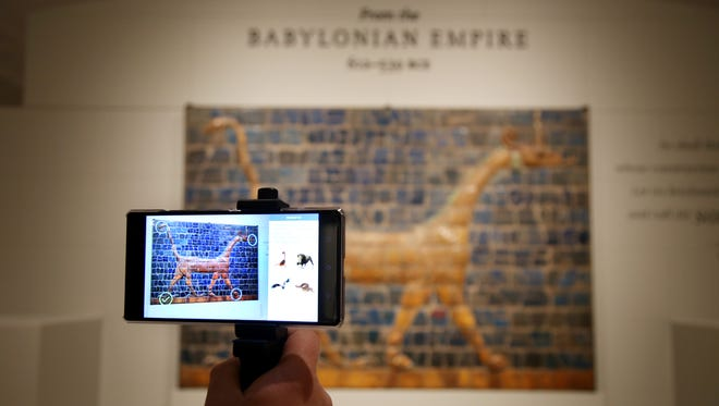 The Detroit Institute of Arts will soon provide a mobile tour using augmented reality which for example will allow visitors to play games like finding parts of different animals in this Mushhushshu- Dragon, Symbol of the God Marduk  when viewed through Lumin in Detroit on Wednesday, Jan. 18, 2017.