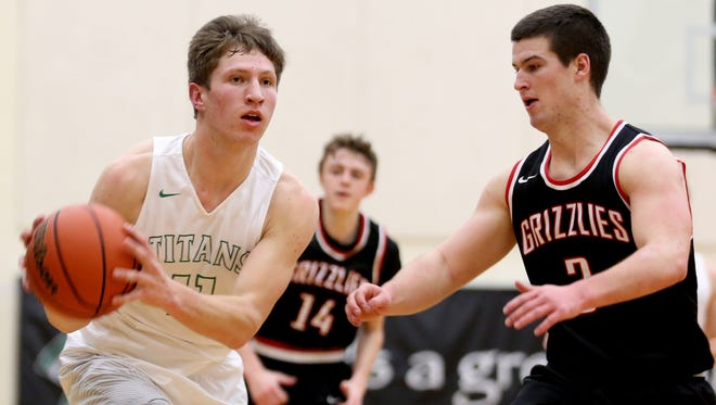West Salem's Jared Oliver (11) looks to pass the ball past McMinnville's Isaiah Coste (14) and Wyatt Smith (3) in the second half of the McMinnville vs. West Salem boy's basketball game at West Salem High School on Friday, Jan. 27, 2017. West Salem won the game 74-62.