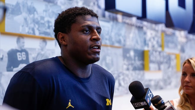 Michigan Wolverines linebacker Mike McCray speaks with the media at the Towsley Museum in Schembechler Hall in Ann Arbor, Aug. 11, 2017.