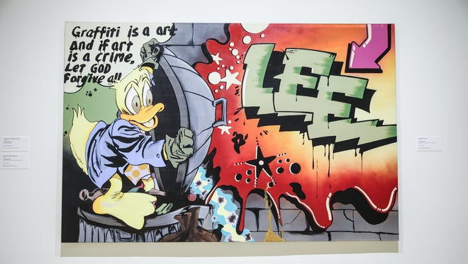 """""""Howard The Duck,"""" 1988, by Lee Quinones, oil on canvass, on display in the City as Canvas: New York City Graffiti from the 70's & 80's exhibition at the Indianapolis Museum of Art on Thursday, Oct. 5, 2017. The show runs Oct. 7, 2017-Jan. 28, 2018."""