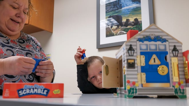 Vincenzo Mirabitur, 4, of Allen Park partakes in a session with speech therapist Jill DeMan at the Exceptional Families Autism Center in Dearborn on Wednesday October 11, 2017. The center includes all medical and educational disciplines in one place to allow for better integration of services and collaboration among clinicians, therapists and educators.