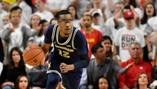 Feb 24, 2018; College Park, MD, USA; Michigan guard Muhammad-Ali Abdur-Rahkman moves up the court during the first half against Maryland at XFINITY Center.