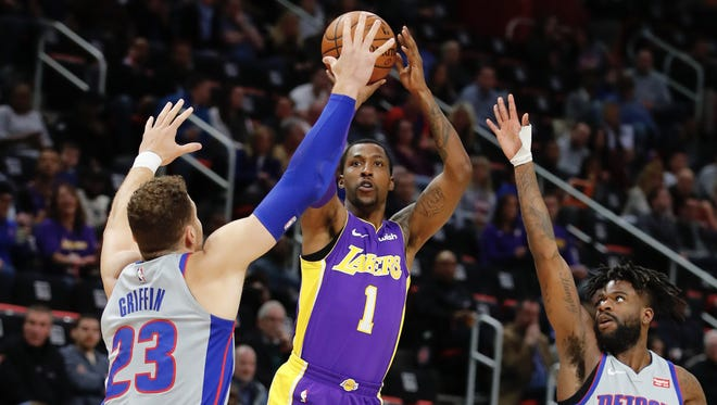Kentavious Caldwell-Pope shoots over the Pistons' Blake Griffin (23) and Reggie Bullock in the first half at Little Caesars Arena on Monday.