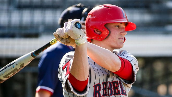 Roncalli Rebel Nick Schnell (7) bats during Marion County quarterfinals at Roncalli High School in Indianapolis, Monday, May 7, 2018.  Roncalli defeated Franklin, 3-2.