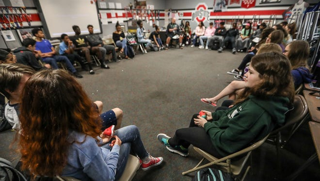 Samantha Gervason, 14, of West Bloomfield, right, and other students gather in a circle for the mental health segment of health class at West Bloomfield High School in West Bloomfield, Mich. on Tuesday, May 8, 2018.