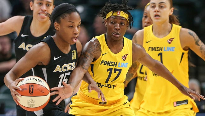 Indiana Fever guard Erica Wheeler (17) tries to knock the ball away from Las Vegas Aces guard Lindsay Allen (15) during first half action at Banker's Life Fieldhouse in Indianapolis, Tuesday, June 12, 2018.