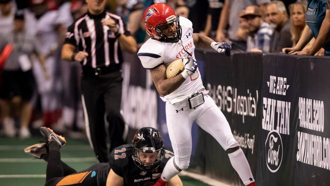 Wide receiver Damond Powell (4) of the Sioux Falls Storm runs the ball against kicker Sawyer Petre (22) of the Arizona Rattlers during the playoff game at Talking Stick Resort Arena on Saturday, June 23, 2018 in Phoenix, Arizona.