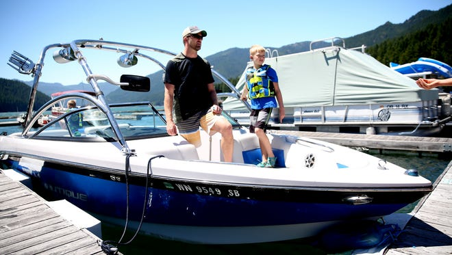 Shawn Anderson, 42, of Camas, Wash., with his son Carter Anderson, 10, get read to boat amid a water quality advisory from the Oregon Health Authority for Detroit Lake on Monday, July 9, 2018.