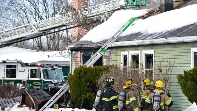 Firefighters battle a house fire Sunday, Jan. 31, 2016 at Redwood Street, Chambersburg. The homeowner was able to escape the fire. No injuries were reported.