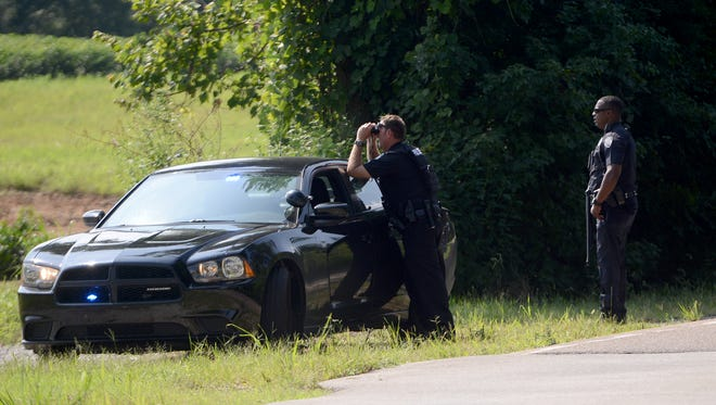 Jackson police officers set up a perimeter on Old Humboldt Road at Passmore Lane and Ashport Road on Thursday morning searching for a man who fled the scene after a shooting outside Black & Decker in North Jackson.