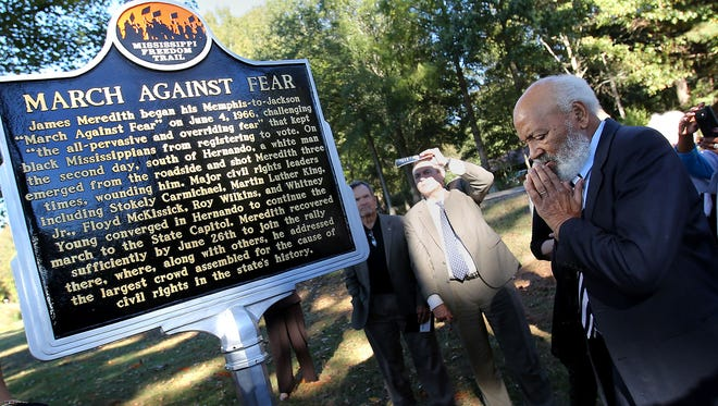 James Meredith pauses for a moment Thursday, Nov. 10, 2016, after unveiling a marker in Hernando, Miss., recognizing the spot where he was shot during the March Against Fear from Memphis to Jackson in 1966.