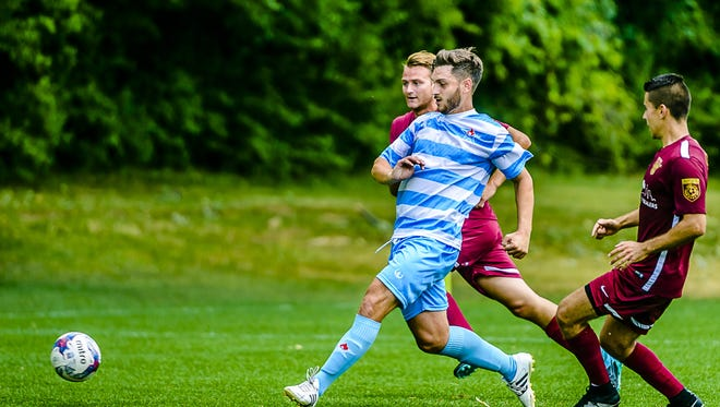 Lansing United captain James DeCosemo is helped the amateur club get out to a 4-0-0 start in the National Premier Soccer League season.