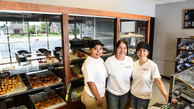 Vichara Chheang, Gabby Redcay and Visal Redcay, owner-operator pose for a picture at Donut Break, a new doughnut shop in Annville that has opened up.