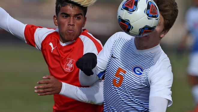 Wooster's battles for the ball against Bishop Gorman's    Alex Dagelar in the Nevada State Championships semifinal game at North Valleys on Friday Nov. 10, 2017.