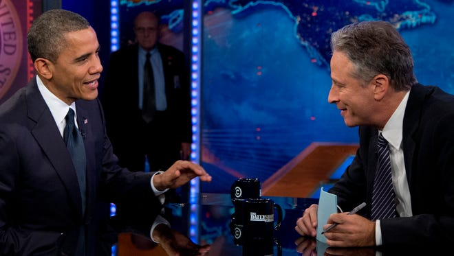 """In this Oct. 18, 2012, photo, President Barack Obama talks with Jon Stewart during a taping of his appearance on """"The Daily Show with John Stewart,"""" in New York."""