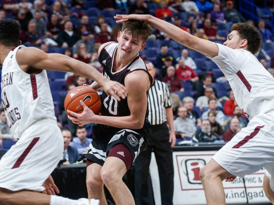 Ryan Kreklow (20) is fouled during Missouri State's quarterfinal game against Southern Illinois in the MVC Tournament at the Scottrade Center on Friday, March 2, 2018 in St. Louis, MO.