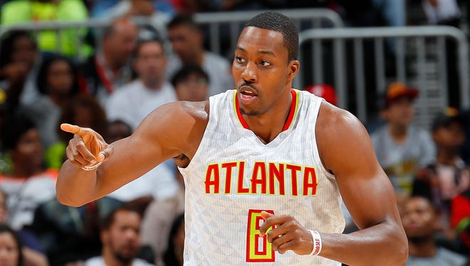 Atlanta Hawks center Dwight Howard reacts after scoring a basket against the Cleveland Cavaliers at Philips Arena on Oct. 10, 2016.