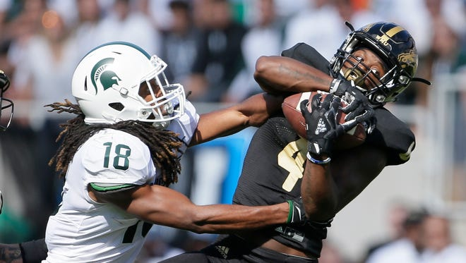 Western Michigan cornerback Darius Phillips intercepts a pass intended for MSU receiver Felton Davis III during the first quarter at Spartan Stadium on Sept. 9, 2017 in East Lansing.