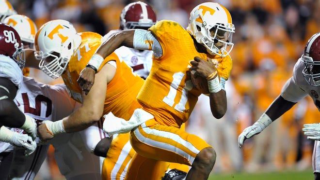 Tennessee quarterback Joshua Dobbs (11) runs for more yardage as the University of Tennessee plays Alabama at Neyland stadium.