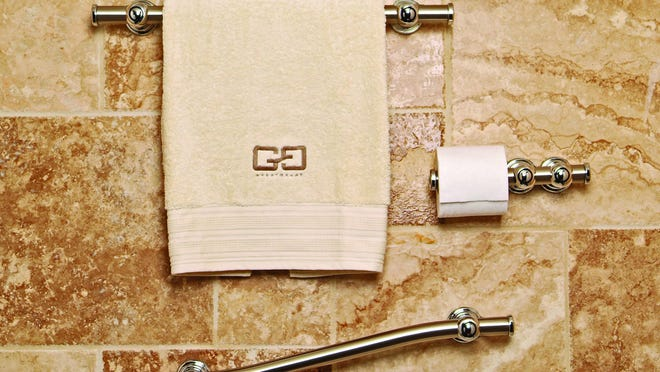 This photo provided by Best Bath Systems shows the Horizon and Wave Signature Series grab bars in satin nickel.