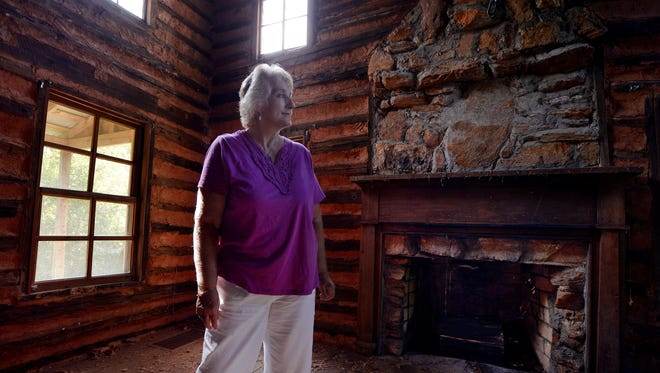 Gayle Jackson says her late husband wanted to fix up a historic cabin that sits on their property. She said he had also started digging a hole for a pool nearby. Charles Jackson died in an auto accident in May, leaving Gayle alone to tend to 22 acres of land in Campobello, South Carolina. Here, on Tuesday, Gayle looks around the inside of the cabin and points out the fixes Charles planned to make.
