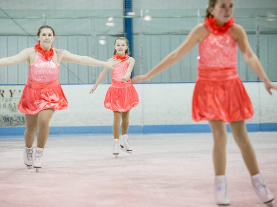 Port Huron Figure Skating Club members Erin Rich, 14, Maggie Higgins, 11, and Grace Durica, 13, practice a routine Tuesday, Feb. 23, 2016 at Glacier Pointe.