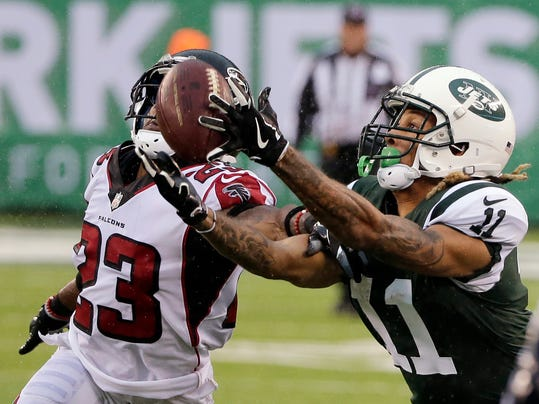 FILE - In this Oct. 29, 2017, file photo, New York Jets wide receiver Robby Anderson (11) catches a pass in front of Atlanta Falcons' Robert Alford (23) during the second half of an NFL football game in East Rutherford, N.J. Anderson is becoming one of the most exciting players in the NFL with touchdown receptions in five straight games for the Jets.  (AP Photo/Seth Wenig, File)