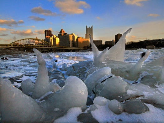 The skyline of Pittsburgh is framed by ice along the bank of the Allegheny River at sunset. Pittsburgh reached a low temperature of minus 9 degrees early Tuesday morning, and a high of 5 degrees.
